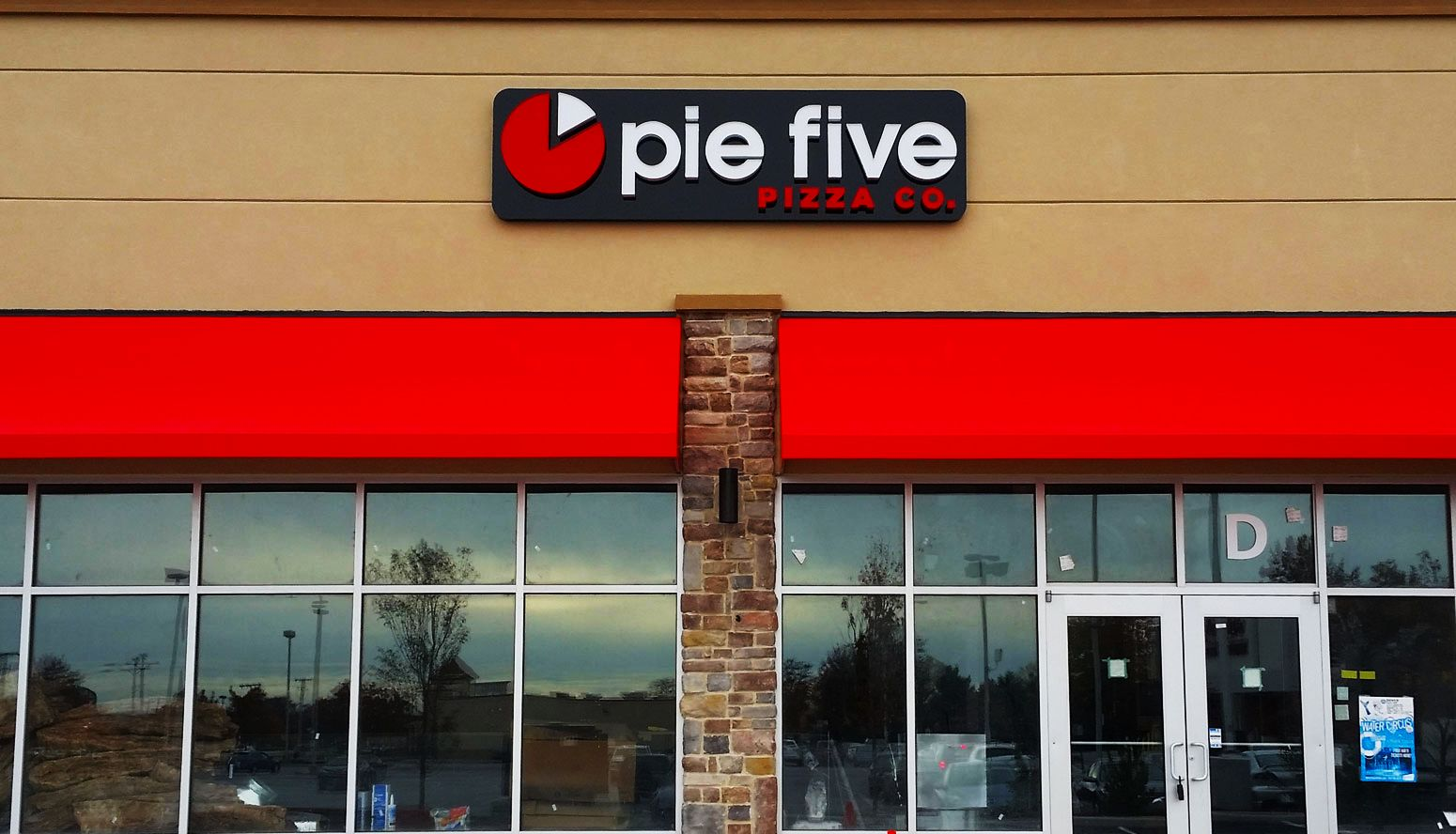 pie five awning building sign